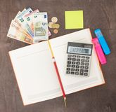 Accounting and business management Banknotes, calculator and Euro banknotes on wooden background. Tax, debit and costing. Banknotes with calculator and notepad Stock Images