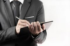 Accounting.Business records in the men's hands Stock Photography