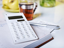 Accounting with calculator Stock Photo