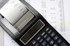 Accounting calculator and figures listing. Top view close up Royalty Free Stock Photography