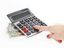 Accounting with calculator and money. Of $20 banknotes on a white background stock images