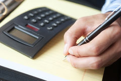 Accounting with calculator and pen Stock Photos