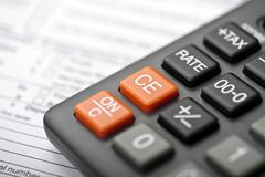 Accounting. Closeup of a Calculator and tax form Stock Photos