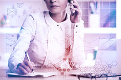 Accounting concept. Attractive european woman talking on the phone and writing in notepad at workplace with abstract financial pattern. Accounting concept. Toned Royalty Free Stock Image