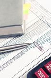 Accounting. diary with calculator on the table pen Stock Image
