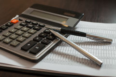 Accounting documents, pens and calculator closeup Royalty Free Stock Photos
