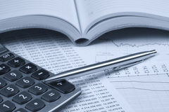 Accounting.dual tone. Calculator, notepad and pen on financial statements Stock Images