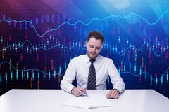 Accounting and finance concept. Businessman doing paperwork at desk on abstract forex chart background. Accounting and finance concept Stock Images