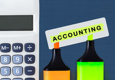 Accounting and financial service. Calculator with highlighters. Royalty Free Stock Photography