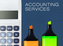 Accounting and financial service. Calculator with highlighters. Royalty Free Stock Photo