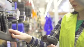 Accounting of goods with the help of barcode scanner. In stock stock video footage