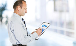 Accounting. investor with the financial plan of revenues of the Stock Photography