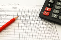 Accounting Ledger. Handwritten General ledger showing bookkeeping using pencil and calculator Royalty Free Stock Photos