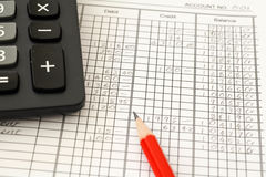 Accounting Ledger. Handwritten General ledger showing bookkeeping using pencil and calculator Stock Photo