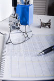 Accounting Ledger office desk. An accounting ledger on a desk with various desk top accessories Royalty Free Stock Photos