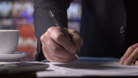 Accounting occupation working on tax return forms at desk in office. Accounting industry business person working on tax return finance form on calculator at desk stock footage