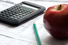 Accounting paperwork with data files. And a red apple Royalty Free Stock Photos