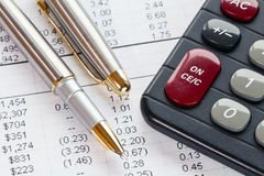 Accounting in process with calculator and pen Stock Photos