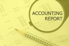 Accounting report words. Magnifier and pencil on a numbers background. Accounting report words. Magnifier and pencil on a calculation background Royalty Free Stock Images