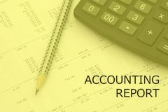 Accounting report words. Pencil and calculator on a numbers background. Accounting report words. Pencil and calculator on a calculation background Stock Photo