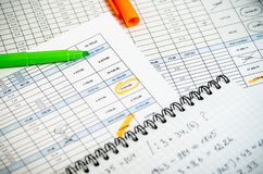Accounting reports in tables, a paper notebook with profit calculations and highlighters stock photos