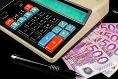 Accounting on retro style calculator Royalty Free Stock Photos