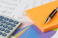 Accounting - Sales with calculator Stock Photography