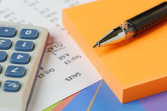 Accounting - Sales with calculator Royalty Free Stock Photography
