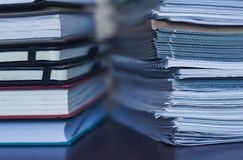 Accounting and taxes. Large pile of magazine and books Stock Images