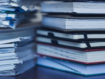 Accounting and taxes. Large pile of magazine and books Royalty Free Stock Image