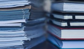 Accounting and taxes. Large pile of magazine and books Royalty Free Stock Photography