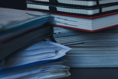 Accounting and taxes. Large pile of magazine, notebook and books closeup stock photos