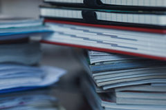 Accounting and taxes. Large pile of magazine, notebook and books closeup Stock Images