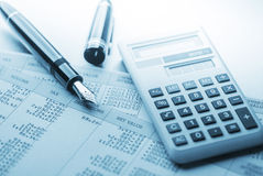 Accounting. Work space with calculator,pen and profit and loss statements Royalty Free Stock Photography