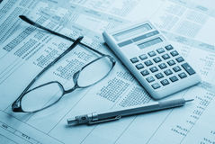 Accounting. Work space with calculator,pen and profit and loss statements Royalty Free Stock Photos