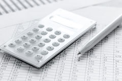 Accounting work space with calculator, profit and tables on stone desk close up Stock Photos