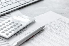 Accounting work space with calculator, profit and tables on stone desk close up. Accounting work space with calculator, profit and tables on stone desk royalty free stock photos