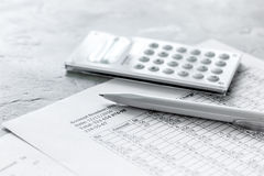 Accounting work space with calculator, profit and tables on stone desk close up Stock Photography