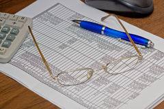 Accounts department, finance. On a table the turnover sheet lies Royalty Free Stock Photo