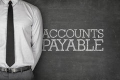Accounts payable text on blackboard. With businessman on side Stock Photo
