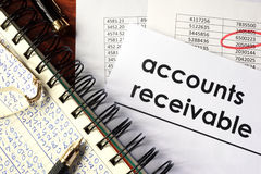 Accounts receivable. Open book with figures and paper with words accounts receivable stock images