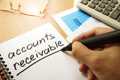 Accounts receivable. Accounts receivable written by hand in a note stock photo