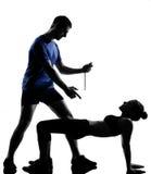 Accouplez l'homme de femme exerçant la séance d'entraînement Photos stock