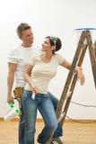 accouplez la première peinture à la maison heureuse Photographie stock libre de droits