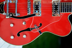 Accoustic Guitar. Guitar, accoustic, red, music, sound Royalty Free Stock Photography
