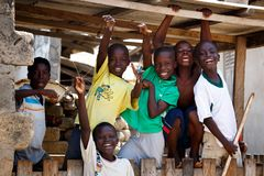 ACCRA, GHANA � MARCH 18: Unidentified african boys greeting to t stock photo