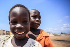ACCRA, GHANA � MARCH 18: Unidentified African boys greeting to t stock image