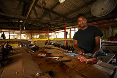 ACCRA, GHANA � MARCH 18: Unidentified Ghanaian butcher  doing hi Stock Photos