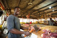 ACCRA, GHANA � MARCH 18: Unidentified Ghanaian butcher  doing hi Royalty Free Stock Images