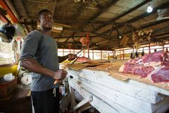 ACCRA, GHANA � MARCH 18: Unidentified Ghanaian butcher doing hi stock images